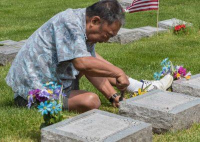 JMAS-Memorial-man-planting-flowers-0656