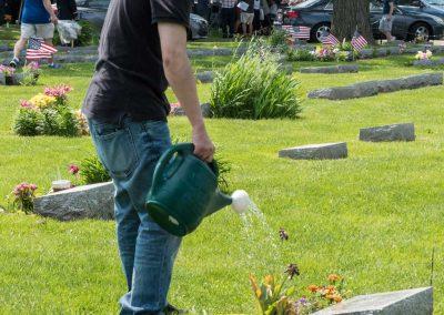 JMAS-Memorial-man-watering-flowers-0623