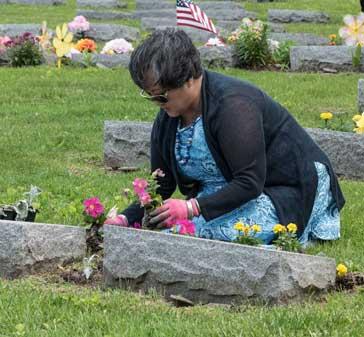 JMAS-Memorial-woman-planting-flowers-0644